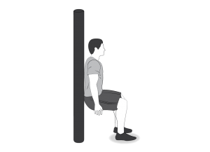 Exercise: Squat level 1 - a man doing squats with his back against a wall or pole